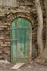 The old wooden door on the ruined wall.