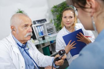 intern observing the procedure