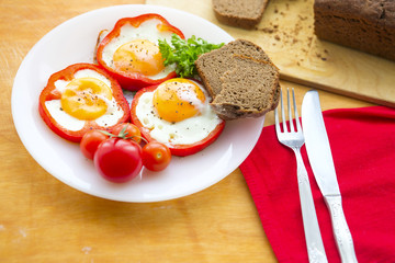 Aluminium Prints Egg Fried eggs in red peppers