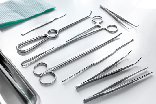 Medical instruments for cosmetic surgery on white table backgrond