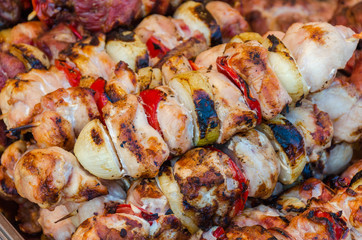 Skewers on wooden stick with tasty pork meat and vegetables mix