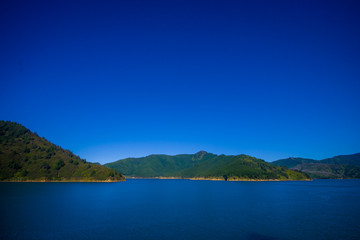 Beautiful landscape with gorgeous blue sky in a sunny day seen from ferry from north island to south island, in New Zealand
