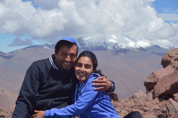 Young happy couple poses on the heights of Acay in Salta, Argentina