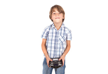 Happy boy with his drone remote control. Isolated on white.