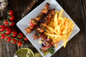 Skewers with fries and salad