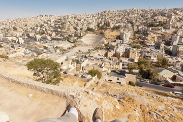 Person's feet over the city of Amman Jordan