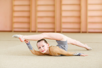 Young girl doing gymnastics.