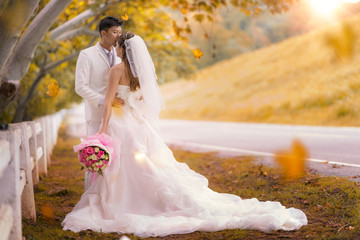 Couple just marriage take wedding honymoon in koria between autumn season