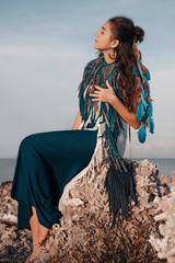 attractive young boho woman outdoors