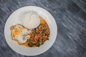 Kao Pad Kra Prao or Thai rice with pork and basil and fried egg