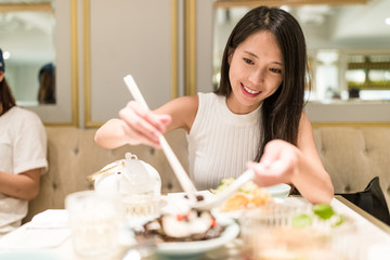 Woman having dinner in chinese restaurant