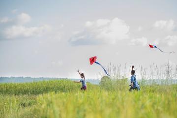 Asian children farmer flying a kite in the rice field.