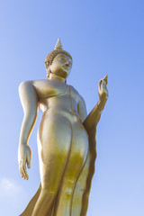 Buddha statue on blue sky background
