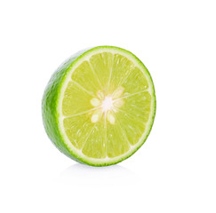 A half of fresh lime fruit isolated on a white background.