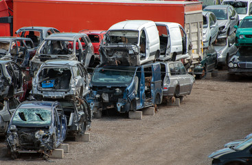 Old vehicles in scrap yard.