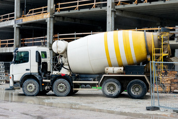 Concrete mixer truck on construction site.
