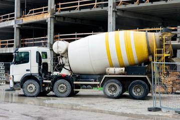 Concrete mixer truck on construction site.