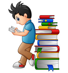 Young boy reading with leaning in the stack of book
