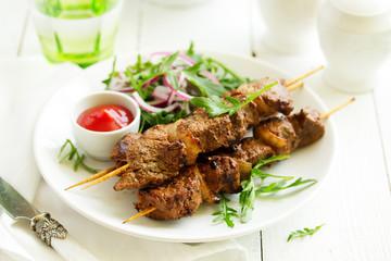Beef shish kebab  on skewers in curry.