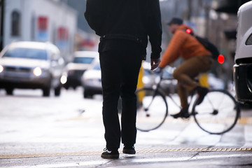 Silhouette of pedestrian on background of other urban transport