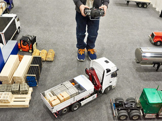 Boy drives truck model with control panel