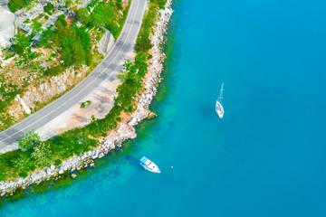 White boats in the sea near the shore
