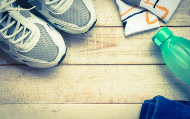 Sport shoes,sock , towel and  water on wood background