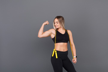 Athletic woman showing bicep