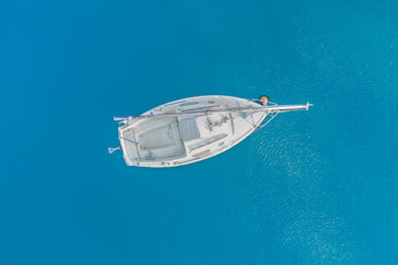 Top view of a white yacht in the blue sea