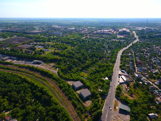 Aerial view. Houses, railway, road and traffic in the city Dnepr, Ukraine.