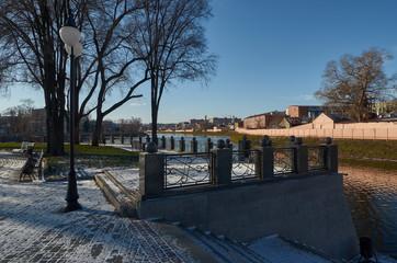 Winter park, embankment, blue sky
