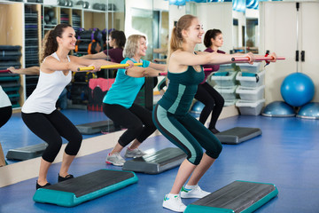 Females working out on aerobic step platform