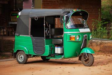 Small car with three wheels. Asian taxi tuk-tuk