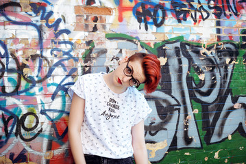 Girl in front of a graffiti wall