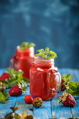 Strawberry smoothie in jars