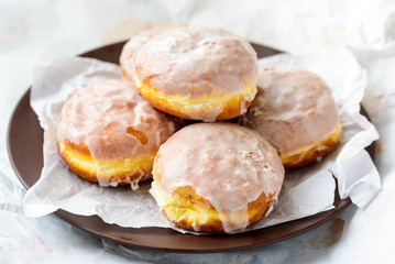 Many donuts on a plate and paper