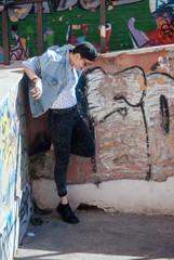 Hip hop hipster dancer on a urban background