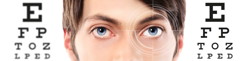 eyes close up on visual test chart, eyesight and eye examination concept in white background