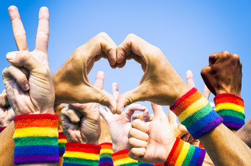 Crowd of hands making supportive signals at gay pride parade