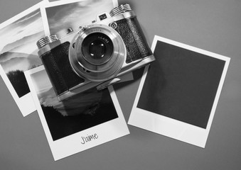 Retro vintage four instant photo frames cards on grey background with images of nature with text j'aime and blank black photo frame with old camera top view in black and white