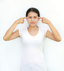 Young asian woman in T-Shirt expression point and touching finger at her eyes.