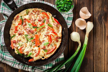 Fresh omelette with bacon and bell pepper