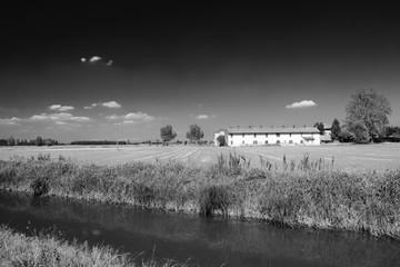 Bicycle lane along the Naviglio of Bereguardo (Italy): farm