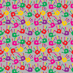 Cute seamless abstract pattern with prints of multi-colored palms