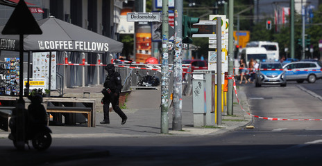Berlin police are looking into a suspicious suitcase on a pavement near Alexanderplatz train station in the capital Berlin