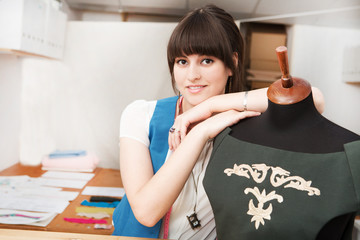 A young fashion designer at her studio.