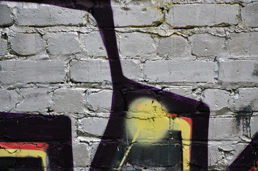 Background image of the wall decorated with colorful abstract graffiti. Street art concept
