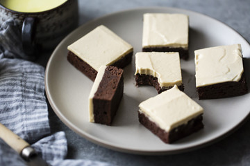 A tahini frosting on top of gluten free chocolate brownies
