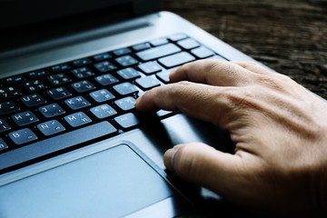 hand on keyboard close up at home office working