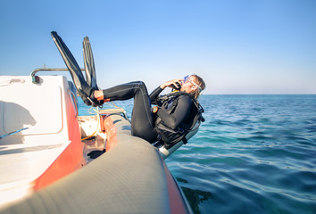 Scuba diver jumping in the water from a boat